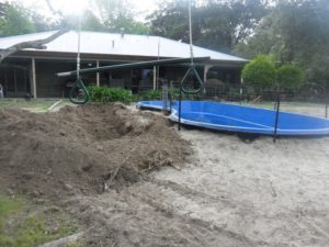 Our Natural Swimming Pond Build:  Boys and their Toys