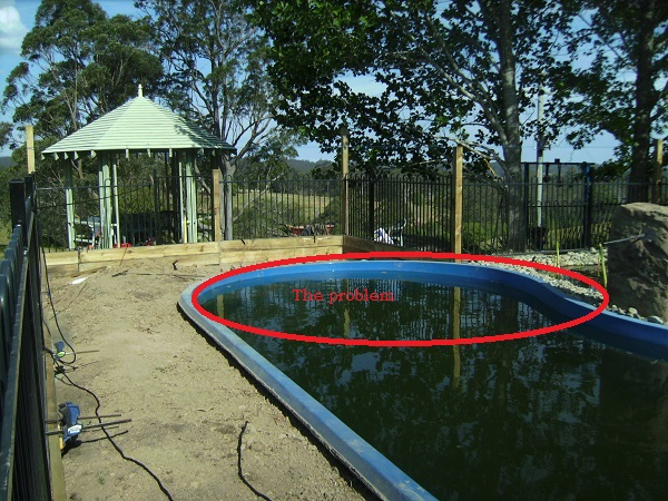 Our Natural Swimming Pond Build:  The day the pond got car jacked