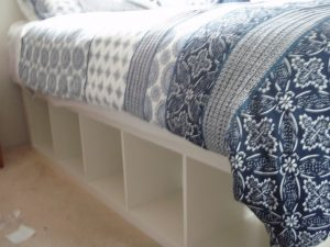 Build your own bed with storage using bookcases