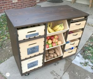 Build your own mobile kitchen island with wooden crate storage!