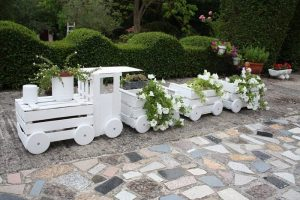 Decorate your yard with a train planter made from old crates!
