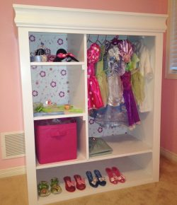 Old entertainment center turned kids armoire