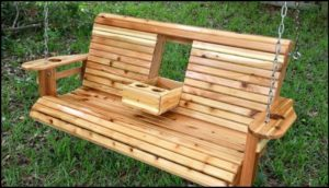 Unwind in your yard with a DIY wood porch swing with cup holders!