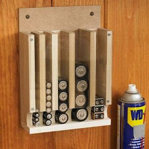 Organize your batteries by building a drop down battery dispenser