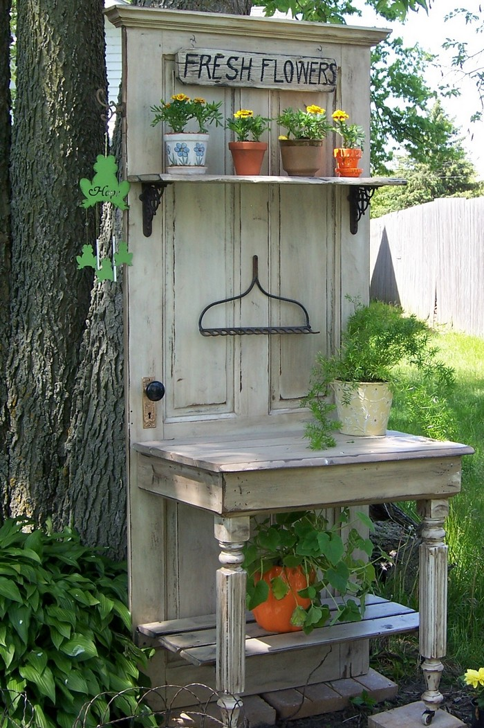 Build a potting bench out of an old wood door your for Diy wood door projects