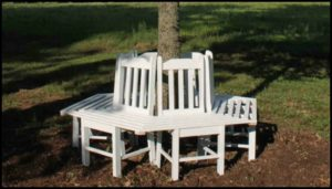 Build a bench around a tree with kitchen chairs!