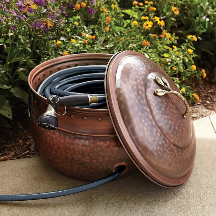Build a beautiful garden hose storage with planter
