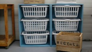 Organizer your laundry area by building this easy laundry basket dresser!