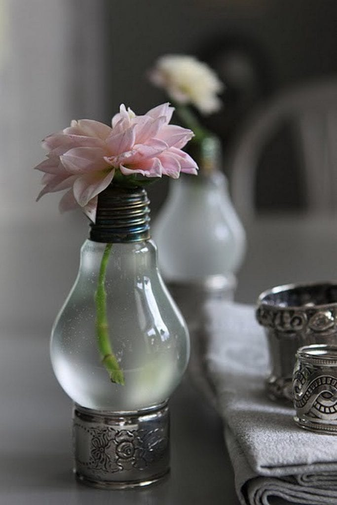 Fill with water, add a flower, find a napkin ring and you're done!