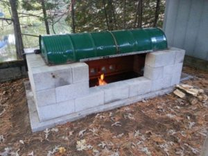 Learn how to build a rotisserie BBQ pit