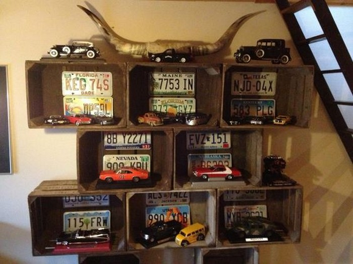 Display your kids 39 toy cars with one of these awesome for Decorating with milk crates