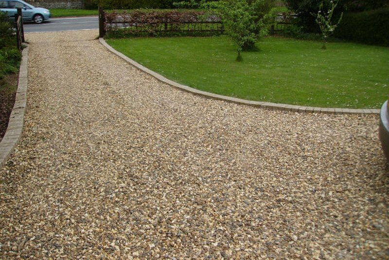 Gravel is the easiest and least expensive option for a driveway