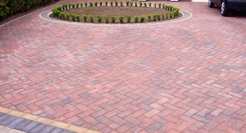 A paved driveway. A concrete bed is highly recommended to ensure durability.