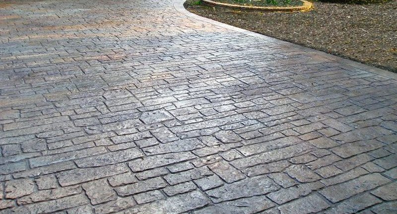 Stamped concrete can be coloured with oxides to give a permanent finish