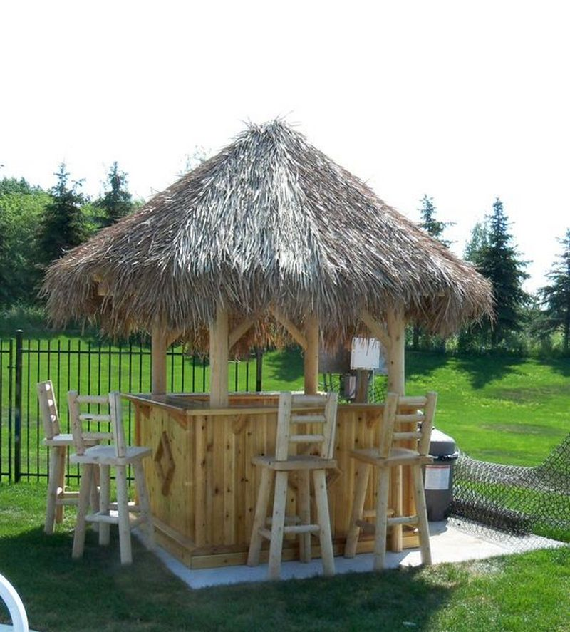 This backyard tiki bar is a perfect spot to entertain family and friends.