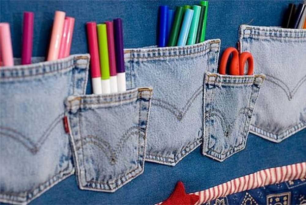 It's hitting two birds with one stone: you re-purpose old jeans and also organize your stuff!