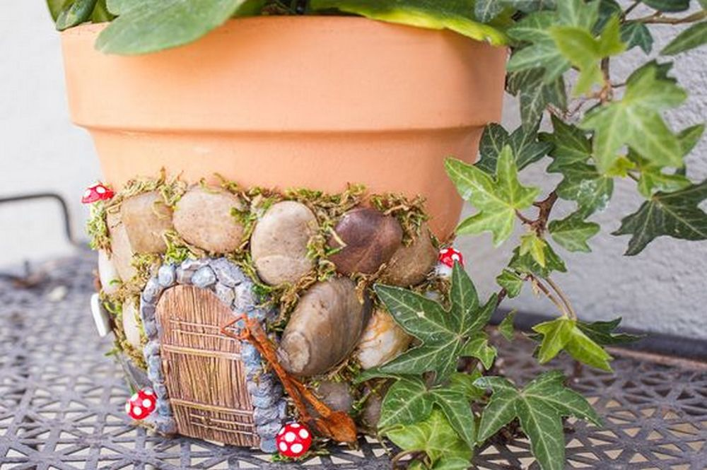 Breathe new life into old pots by turning them into fairy house planters.