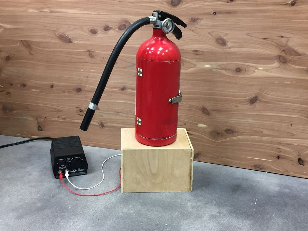 Turn an empty fire extinguisher into your very own mini bar!