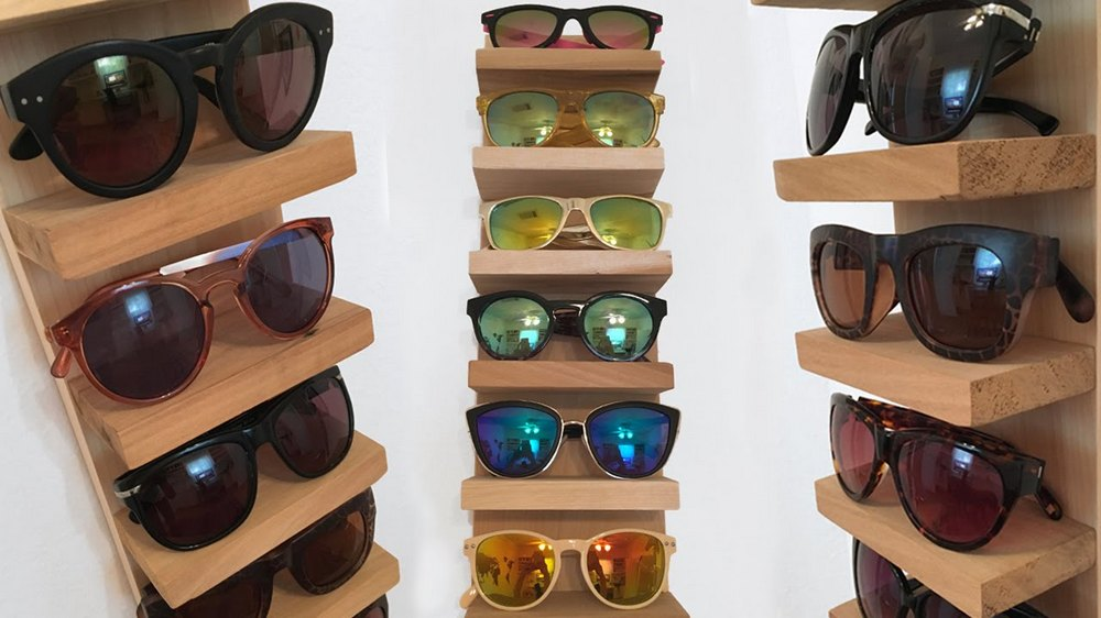 Here's how you can properly store, and display, your sunglasses collection - a DIY Sunglass Rack!