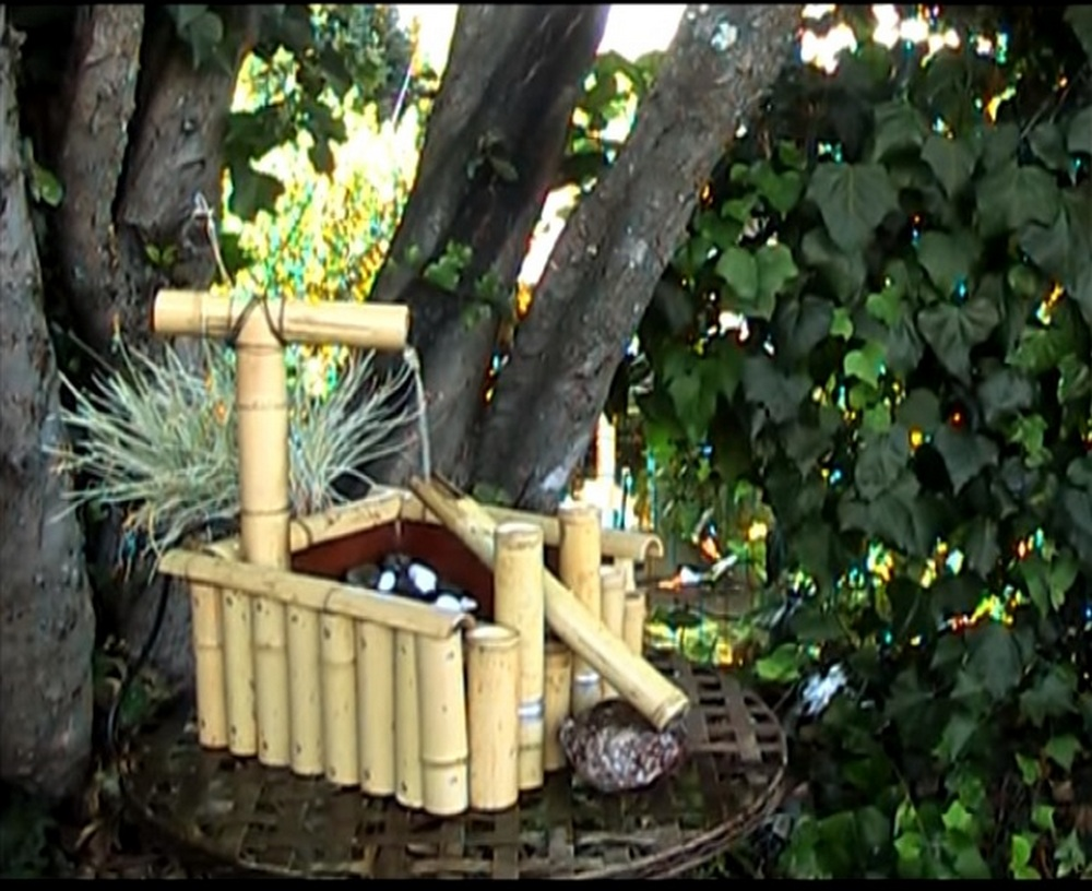 Here's the shishi-odoshi - or the deer scarer - type of bamboo fountain.