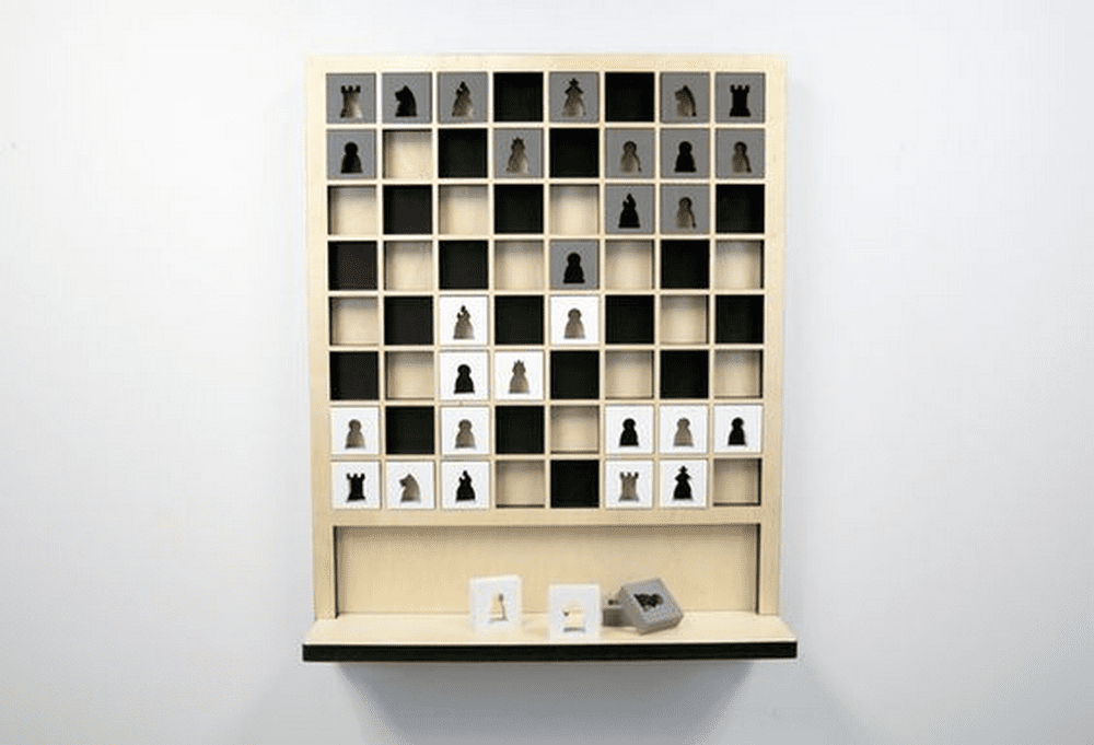 If you're a chess lover, this wall-mounted chess board is exactly what you need for your entertainment area.