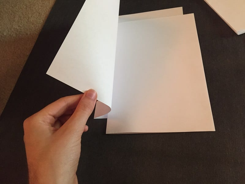 Make a thicker signature by slipping more folded sheets of paper, one by one, into the innermost folded sheet.