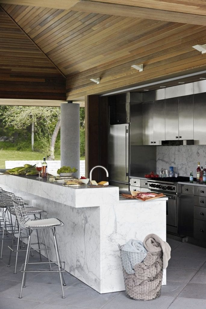 Natural stone tiles like marble and granite can give your outdoor kitchen both a luxurious feel or a rustic vibe.