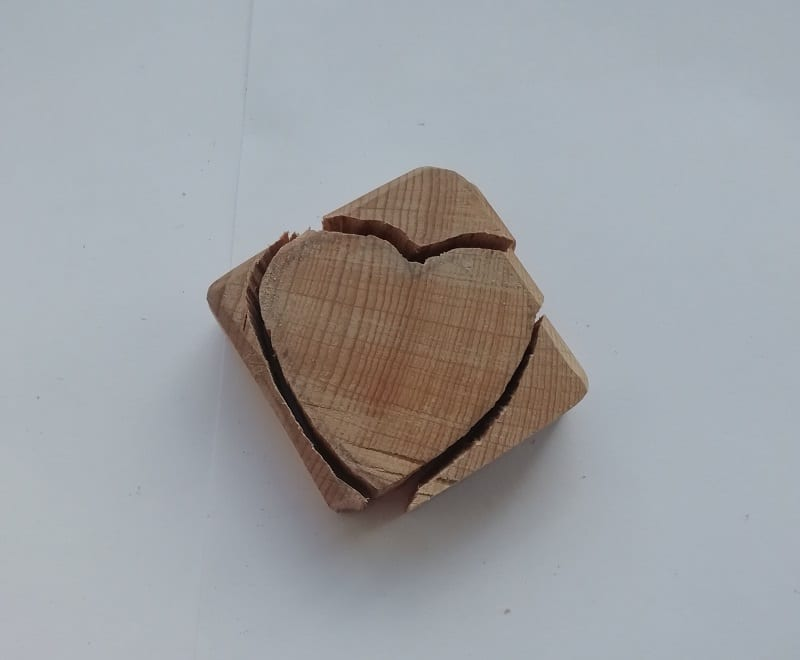 Draw a heart shape on the piece of wood and cut around the drawing using the saw.