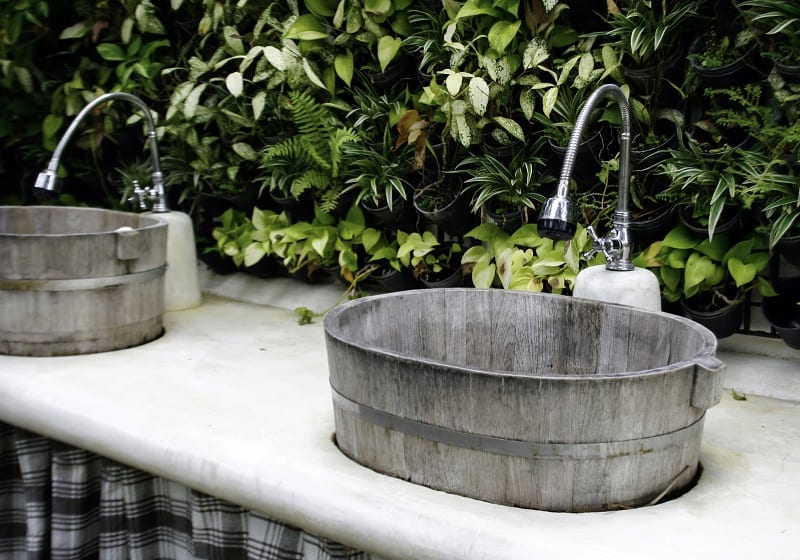 An outdoor sink may seem extravagant, but it could add a practicality to your outdoor space you never imagined.