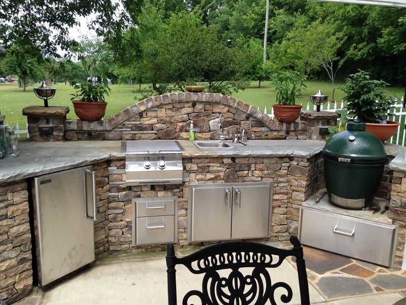 If you have enough space in your backyard, you might consider building a stone-covered grill island.