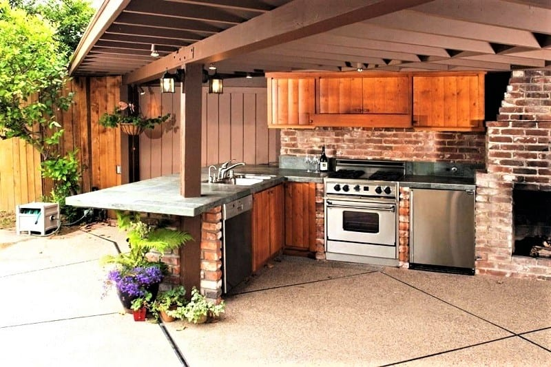 A backsplash of new or reclaimed brick will give your outdoor kitchen a beloved classic look.